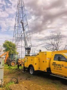 Schaefer Well Co servicing a water pumping windmill