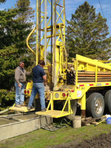 Schaefer Well employees using rig to drill a water well
